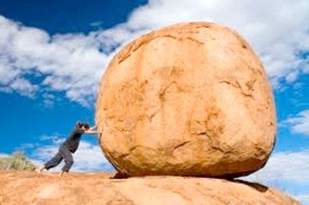 Коса на камінь